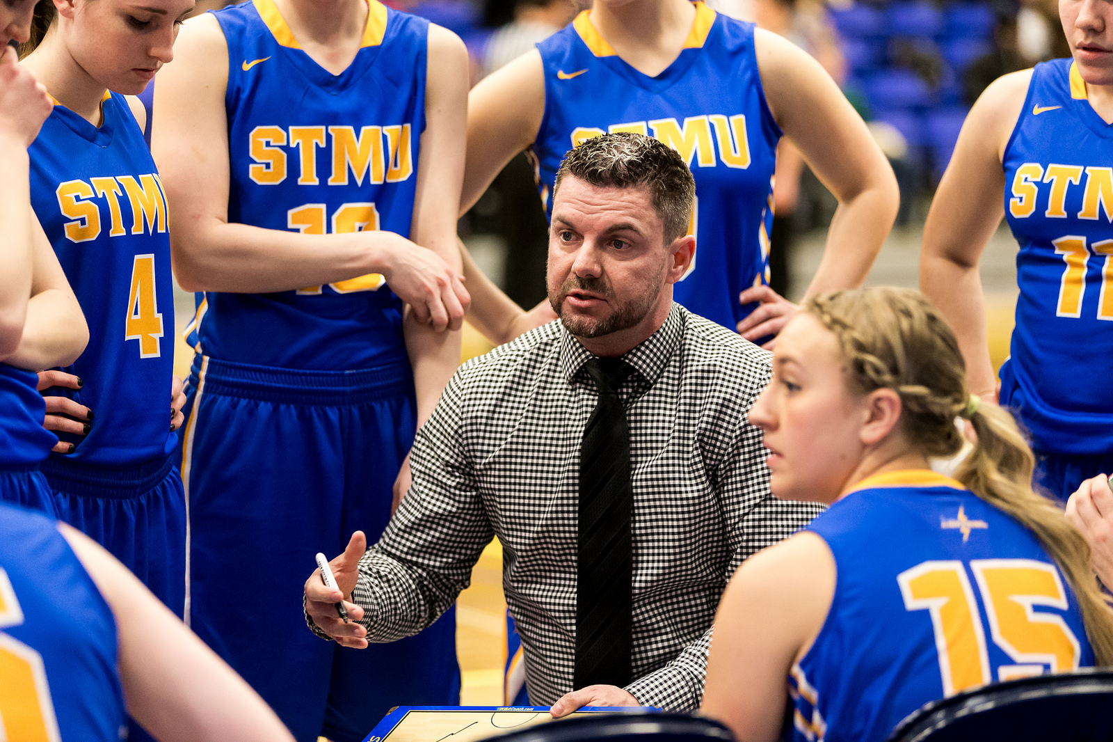 Head coach Steve Shoults goes over plays during a time out called at the 2015 ACAC Women's Basketball Championships at NAIT March 3-6